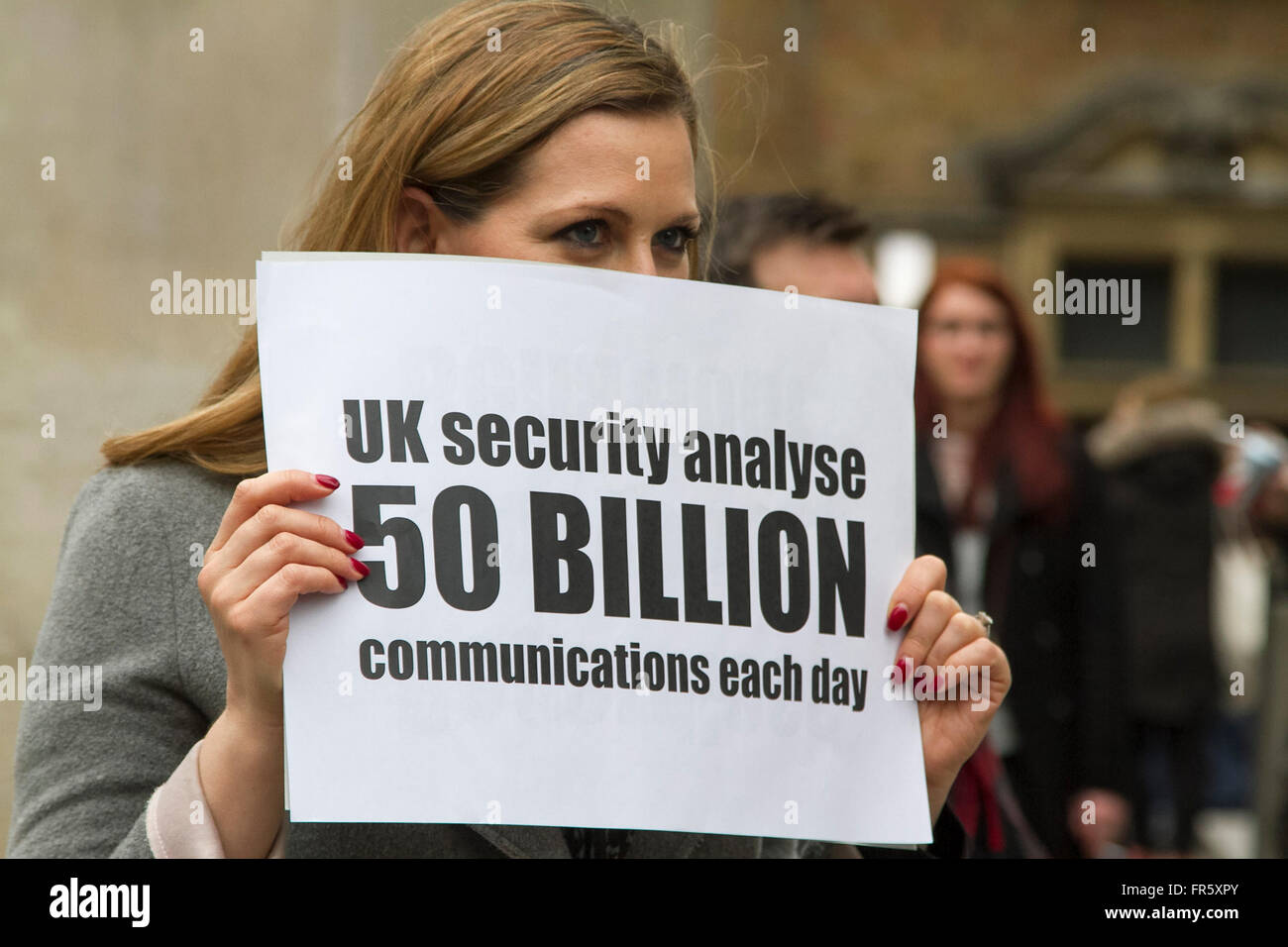 London,UK. 21st March 2016. A woman holds a sign in front of a a television crew highlighting the fact the United - Stock Image