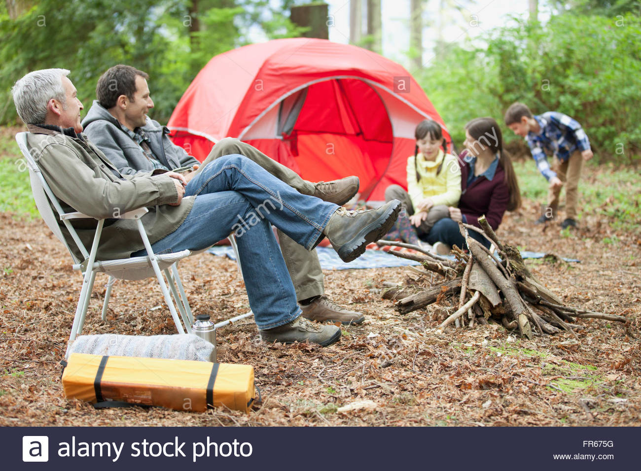 three generations of people out camping - Stock Image