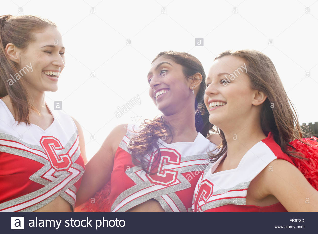 cheerleaders practicing - Stock Image