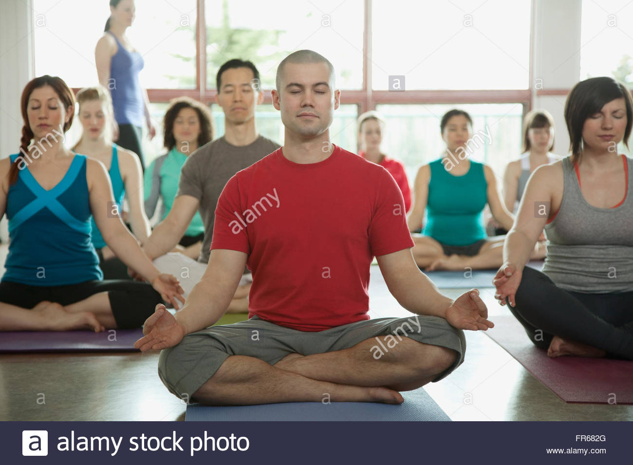 yoga class in the lotus position - Stock Image