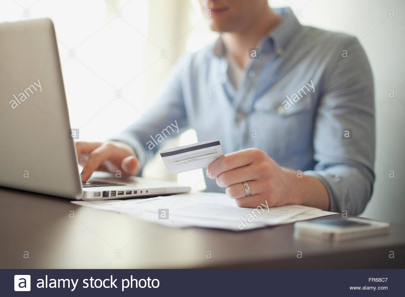 man working on laptop at home - Stock Image