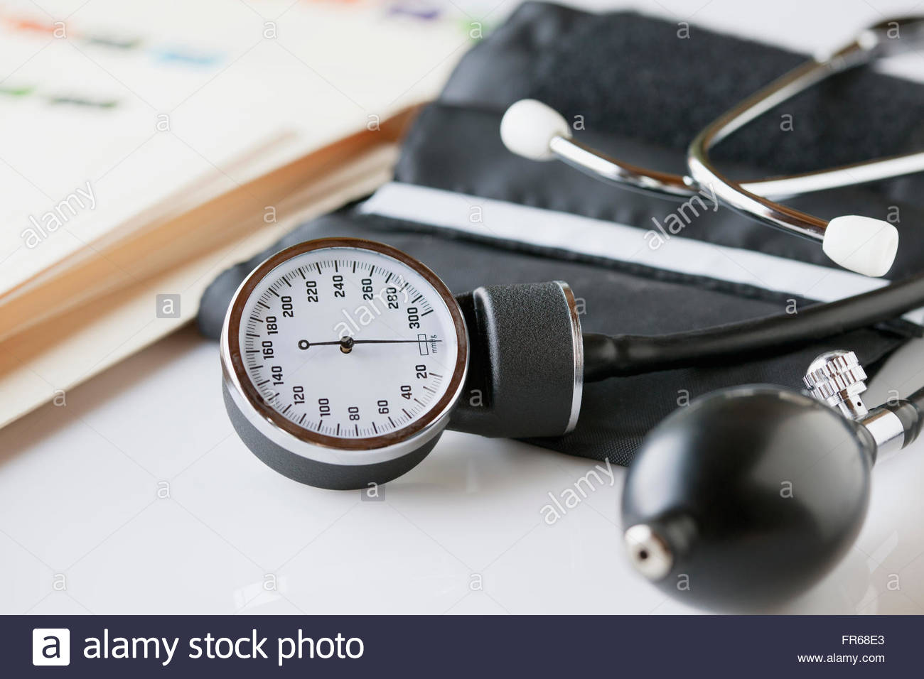 closeup view of blood pressure gauge and cuff - Stock Image