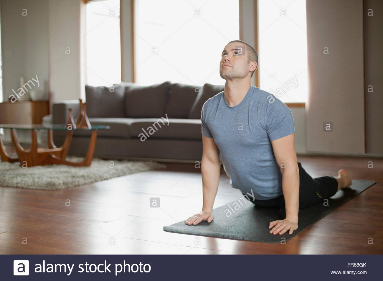 Man Doing Yoga Poses At Home