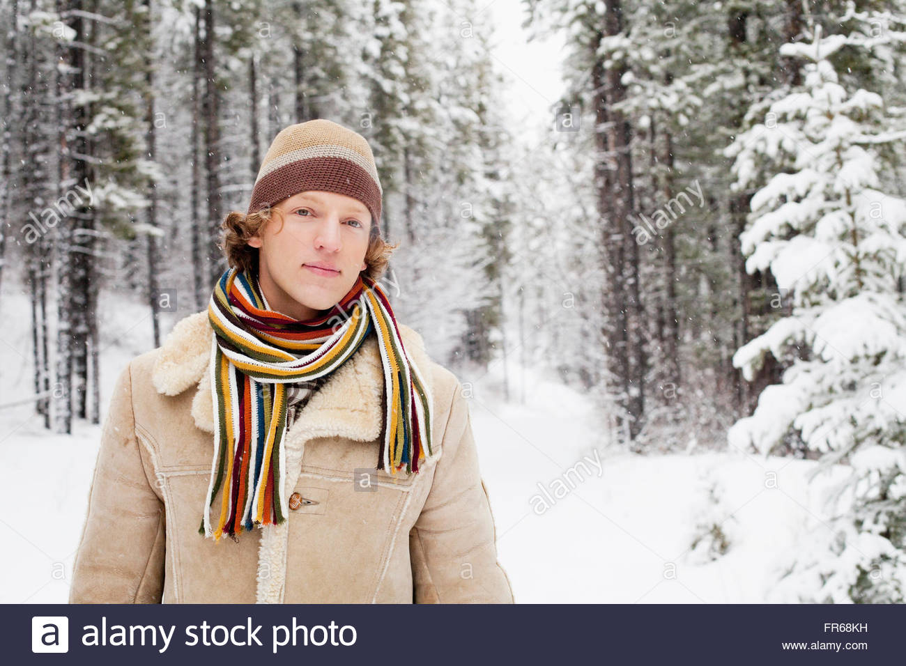 young man enjoying the wintery outdoors - Stock Image