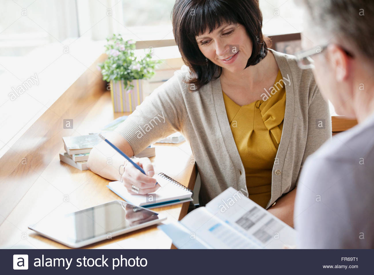 professional taking patient information - Stock Image