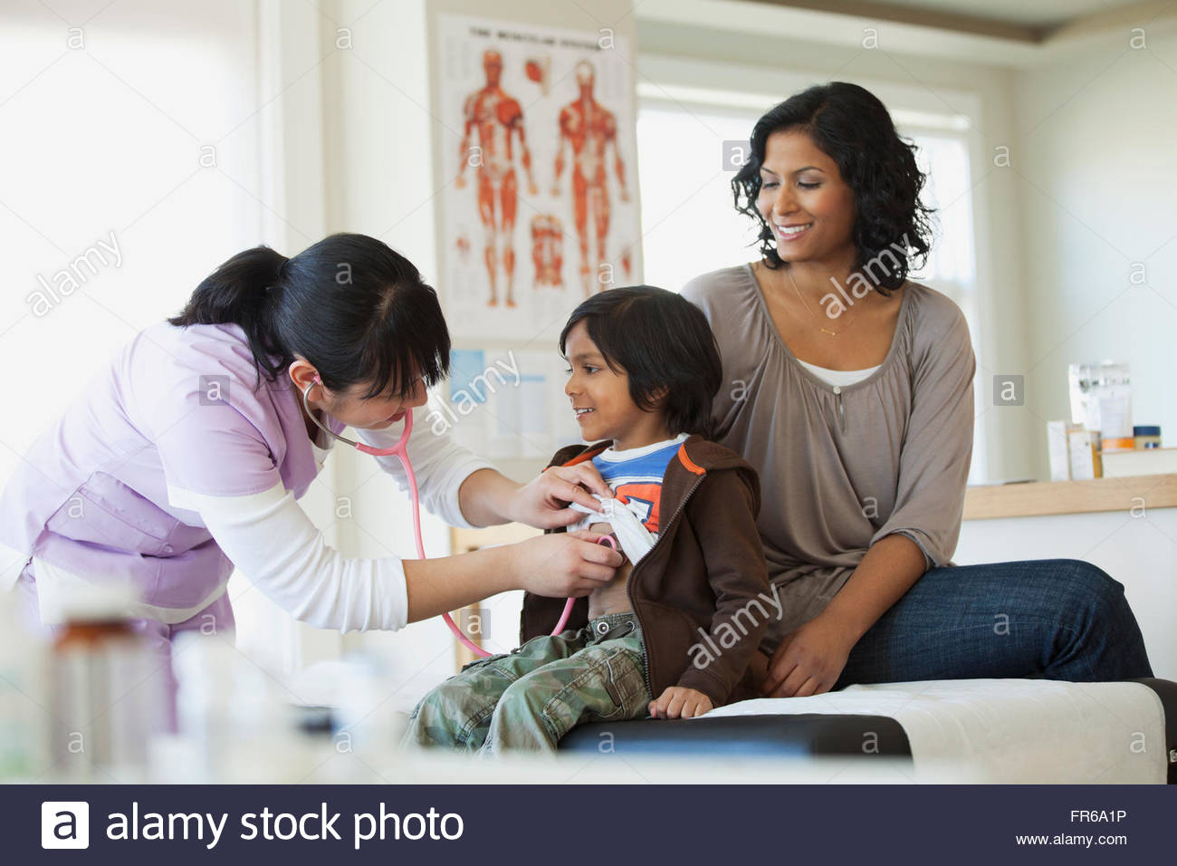 mom and son at medical examination - Stock Image