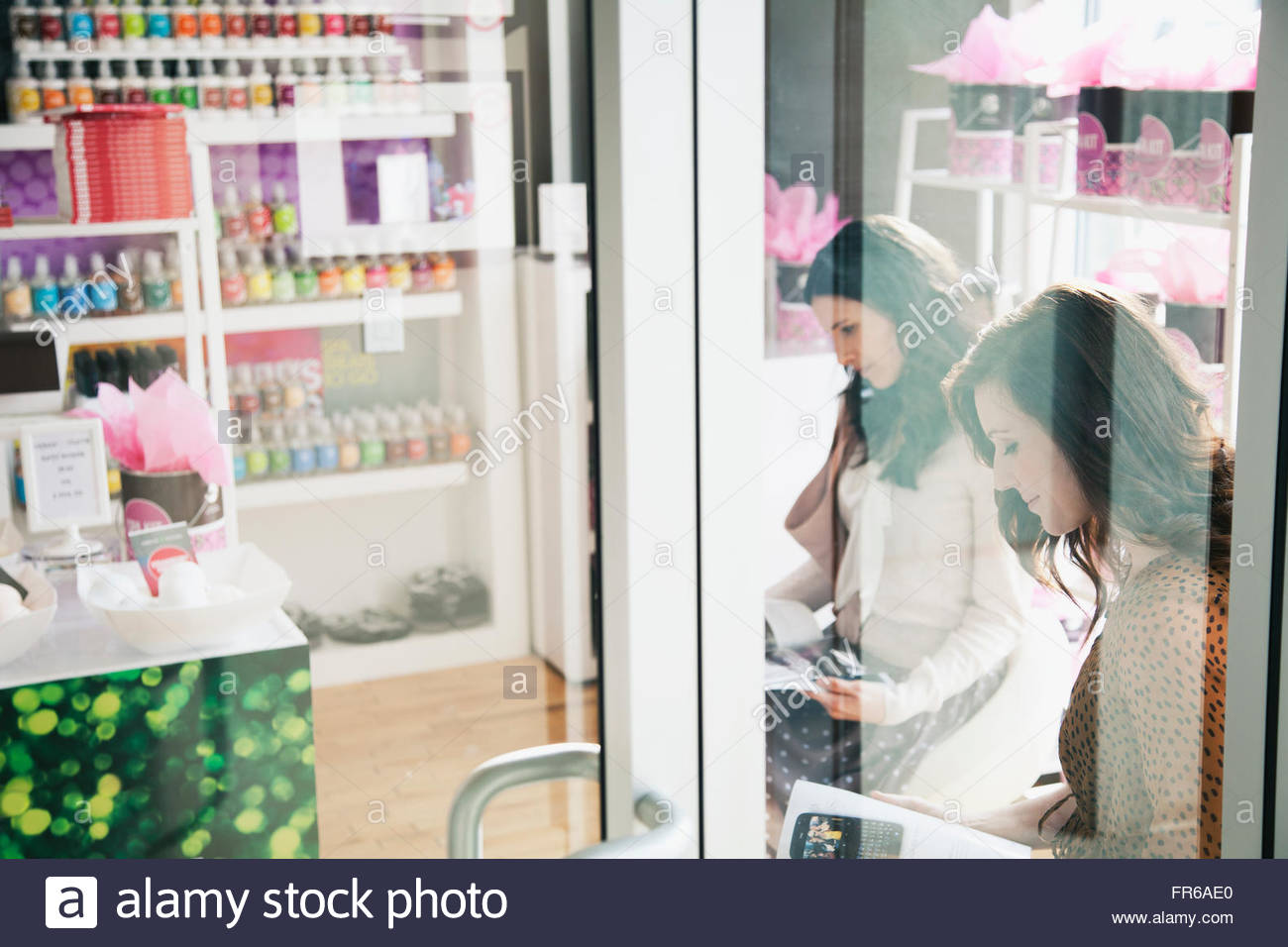 women waiting for salon appointment - Stock Image