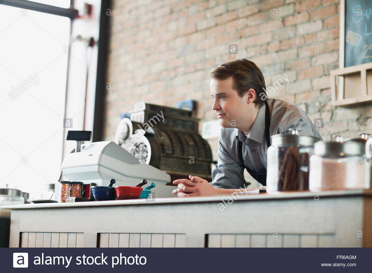 merchant of retail spice store - Stock Image