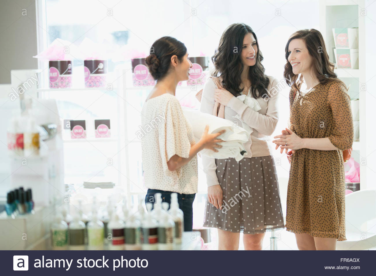 women choosing beauty products at spa - Stock Image