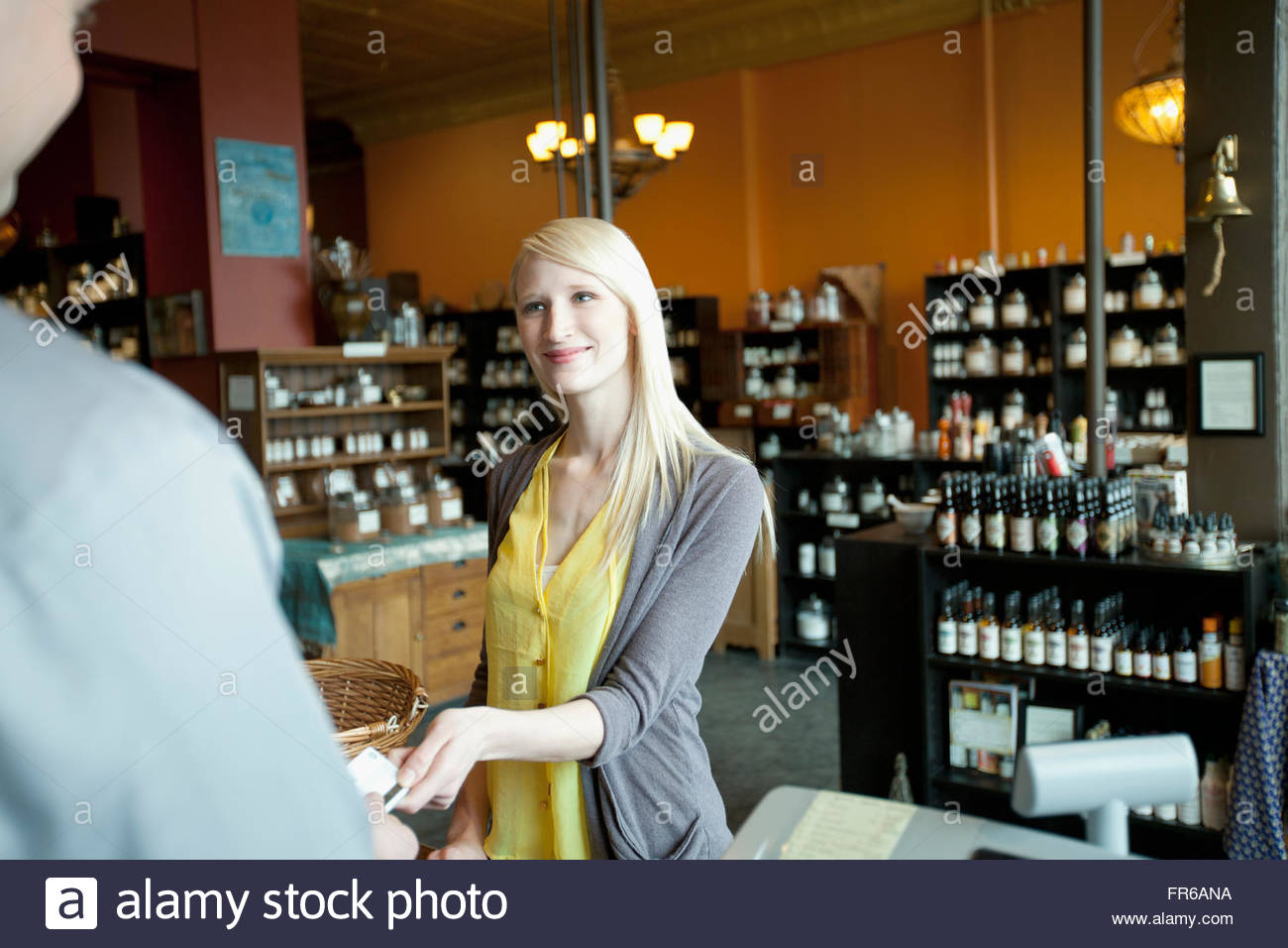 customer paying for product at retail spice store - Stock Image
