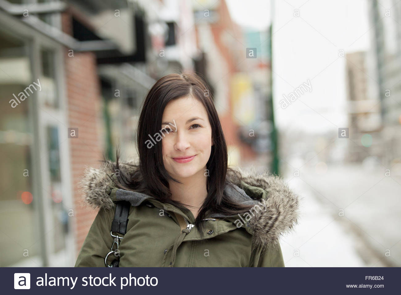 young woman out for a brisk walk - Stock Image