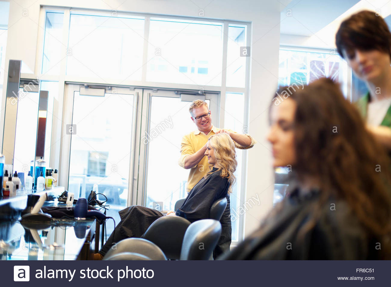 hairstylists working in salon Stock Photo