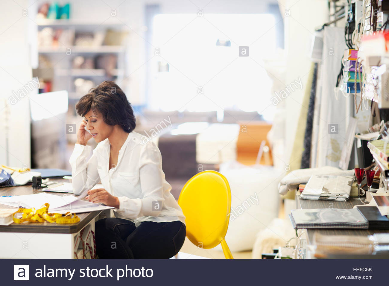 designer on phone call - Stock Image