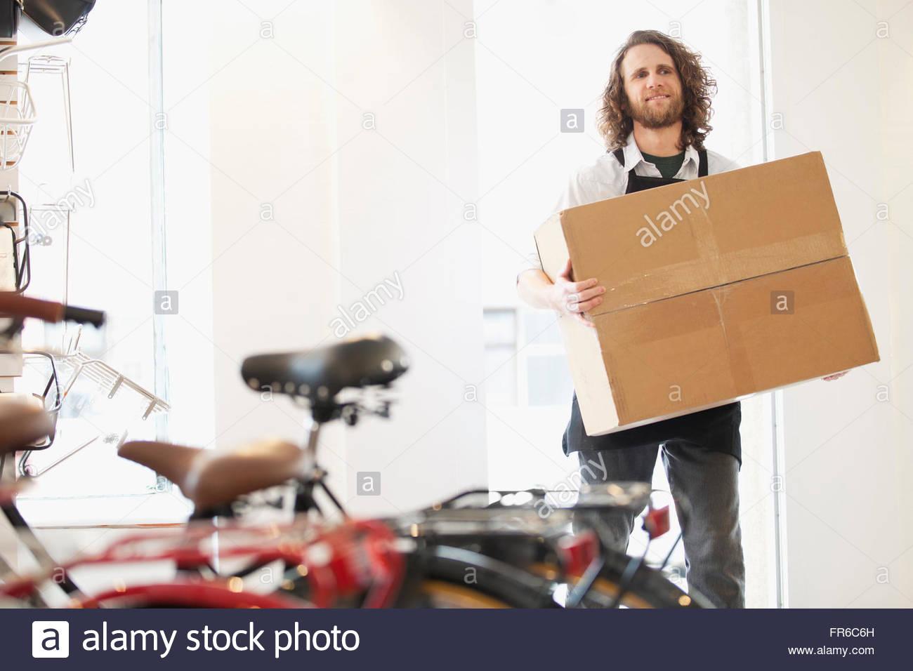 proud bike shop owner - Stock Image
