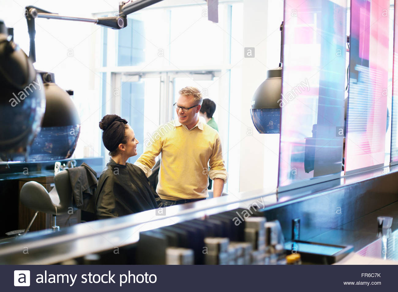 hairstylists working in salon - Stock Image