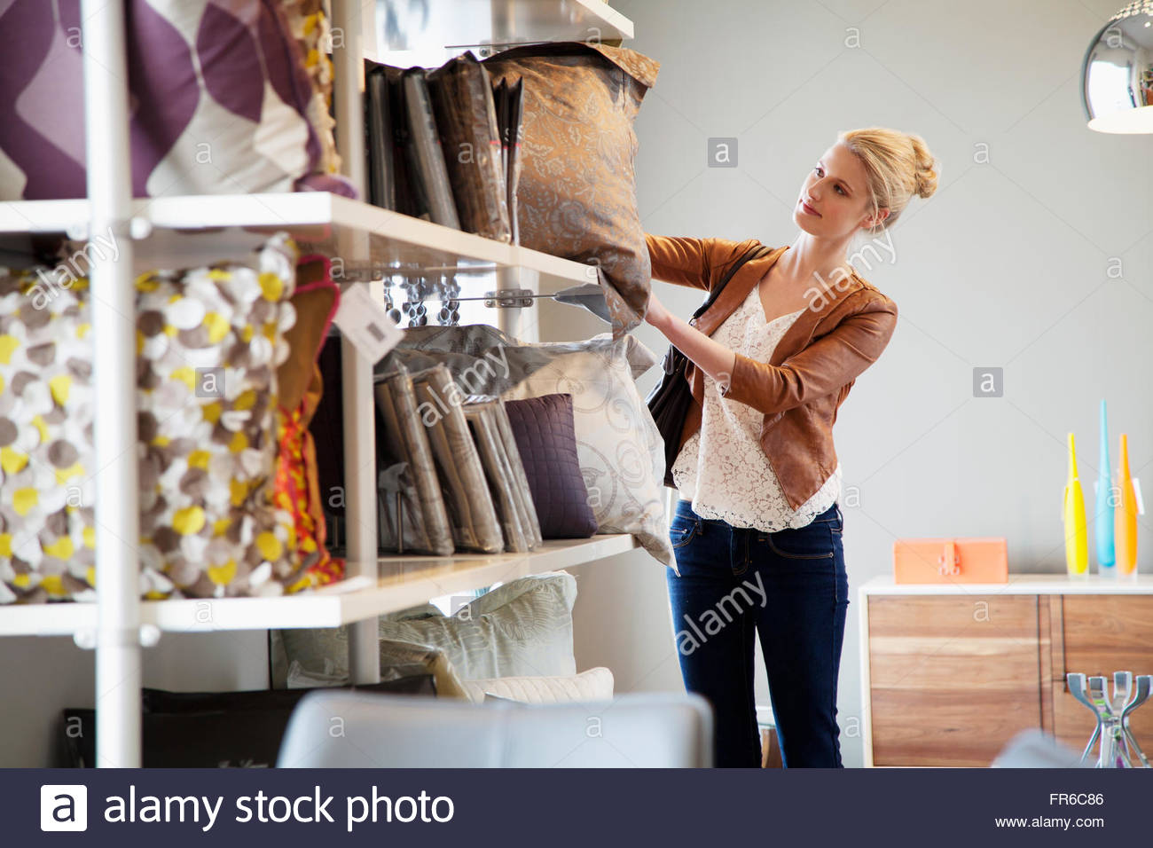 young woman shopping for household products - Stock Image