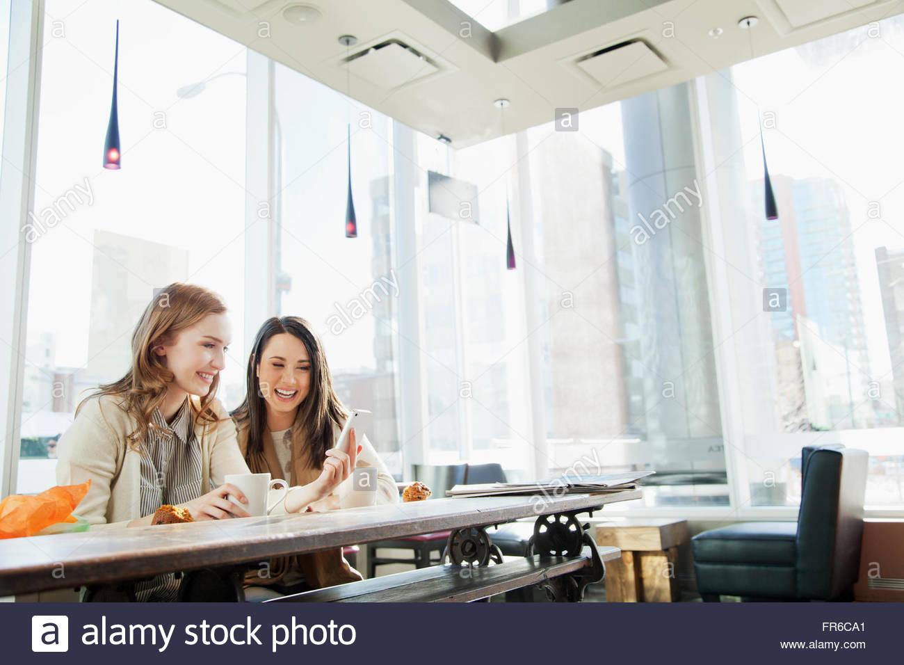 stylish young women having coffee - Stock Image