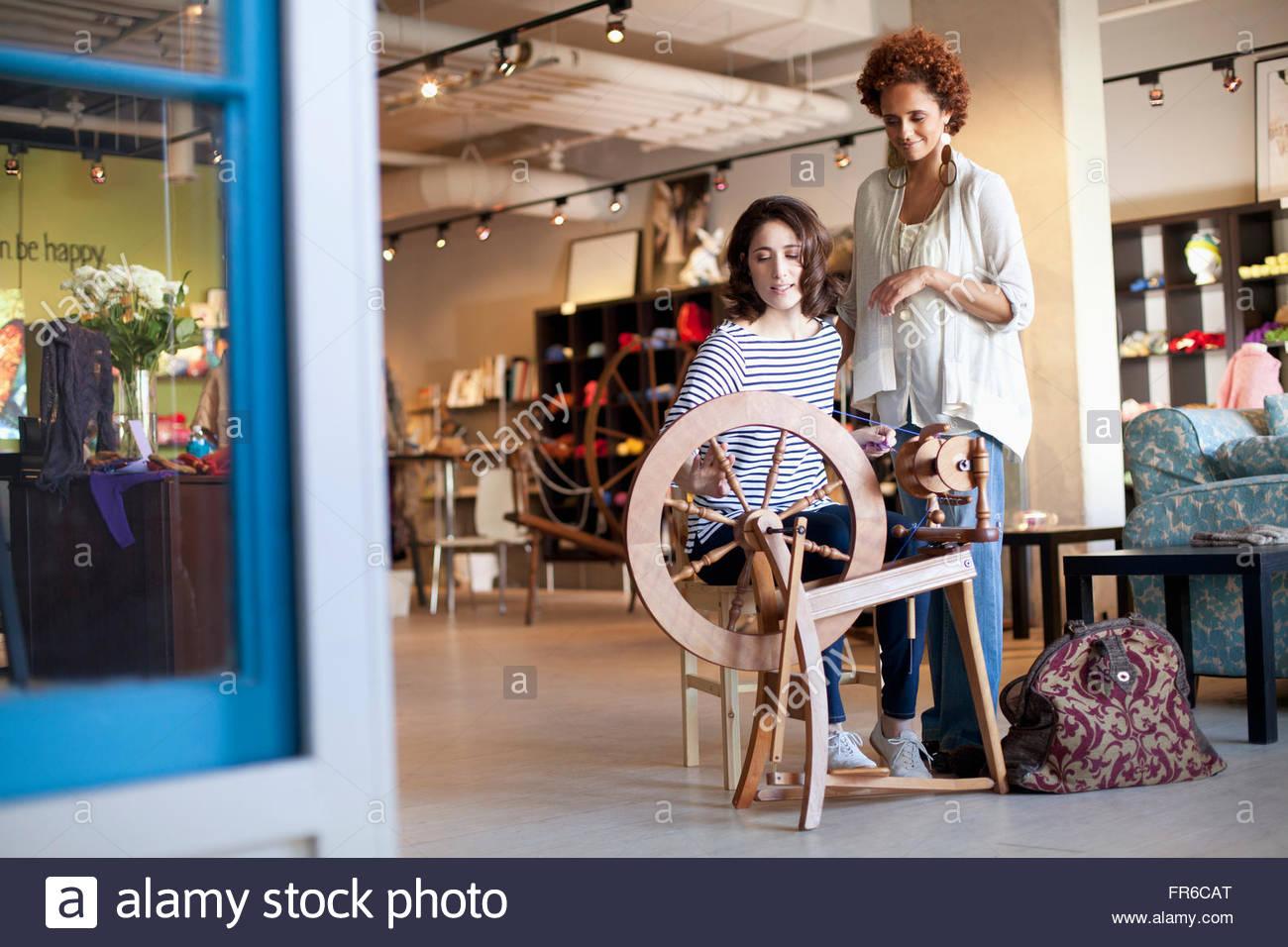 demonstration at yarn store - Stock Image