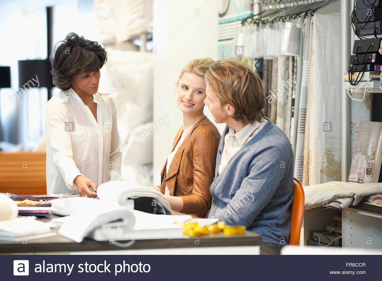 couple in discussion with designer - Stock Image