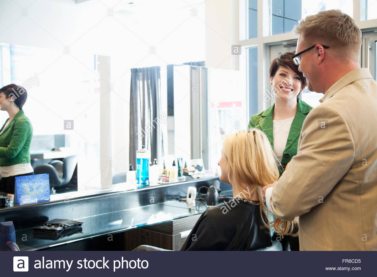 hairstylsts working at hair salon Stock Photo