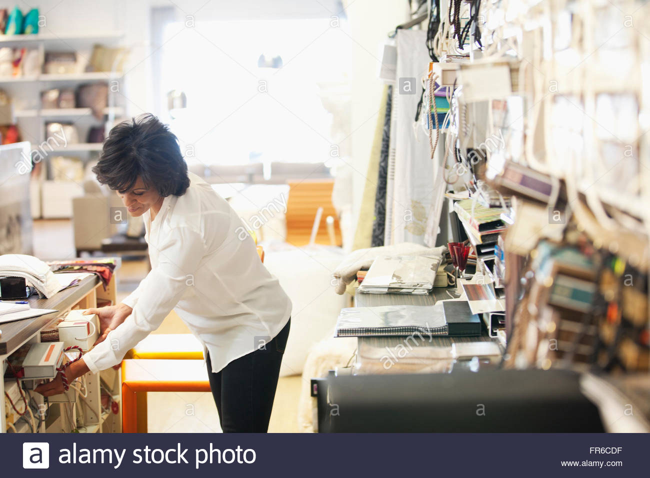 designer pulling samples - Stock Image