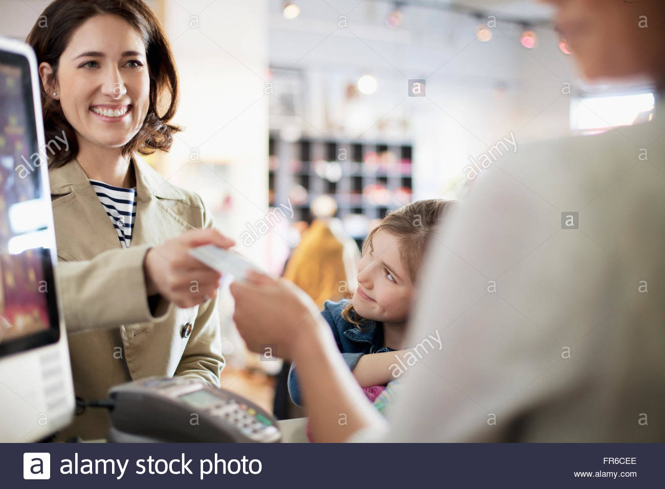 woman paying for purchase - Stock Image