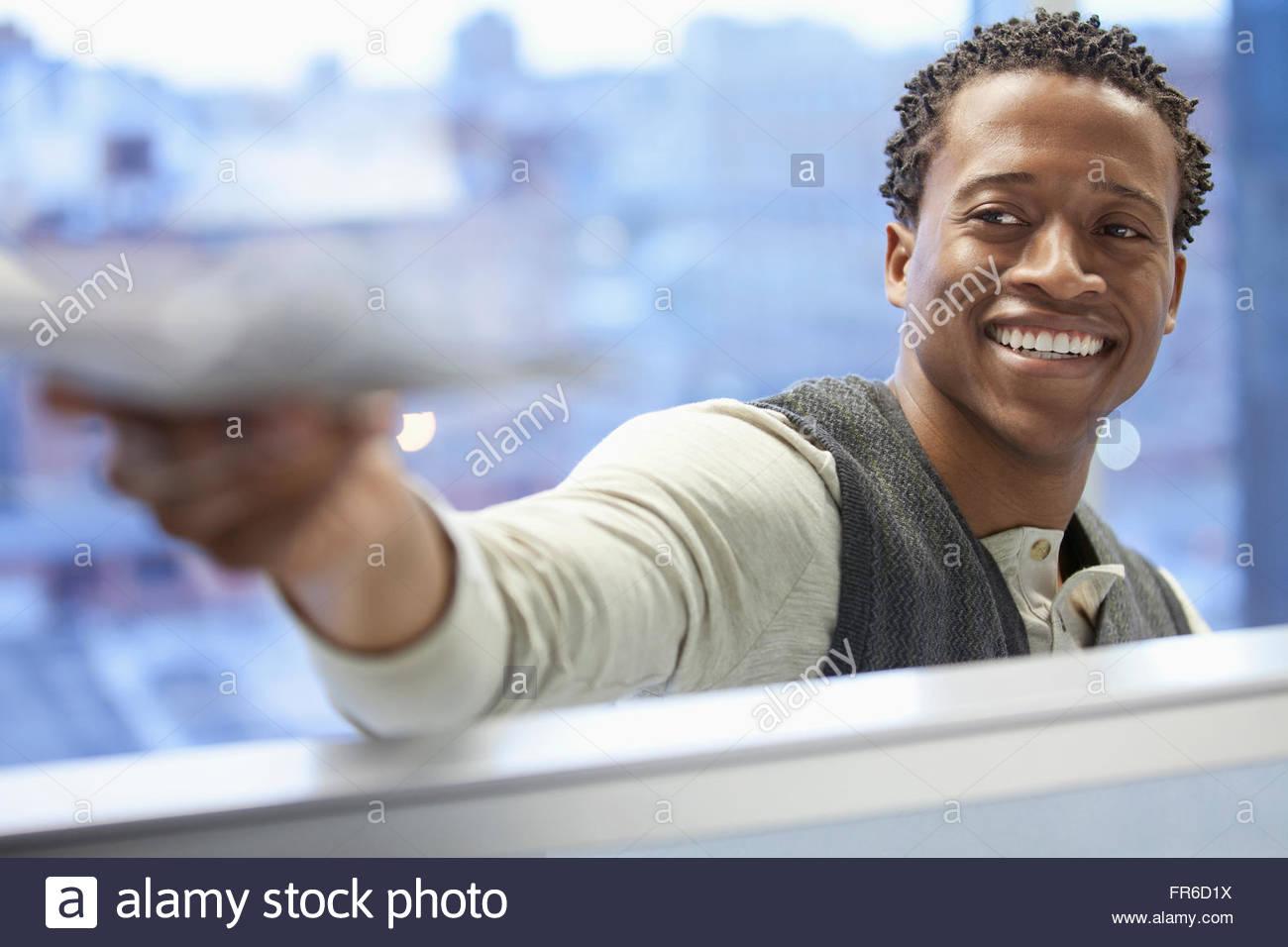 businessman passing paperwork - Stock Image