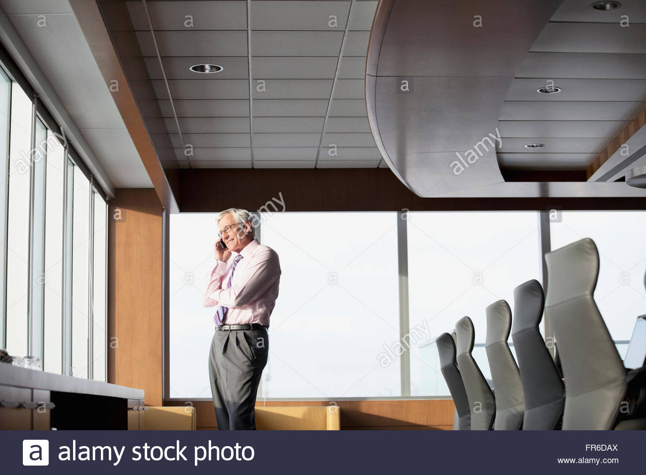 senior business man on phone call - Stock Image