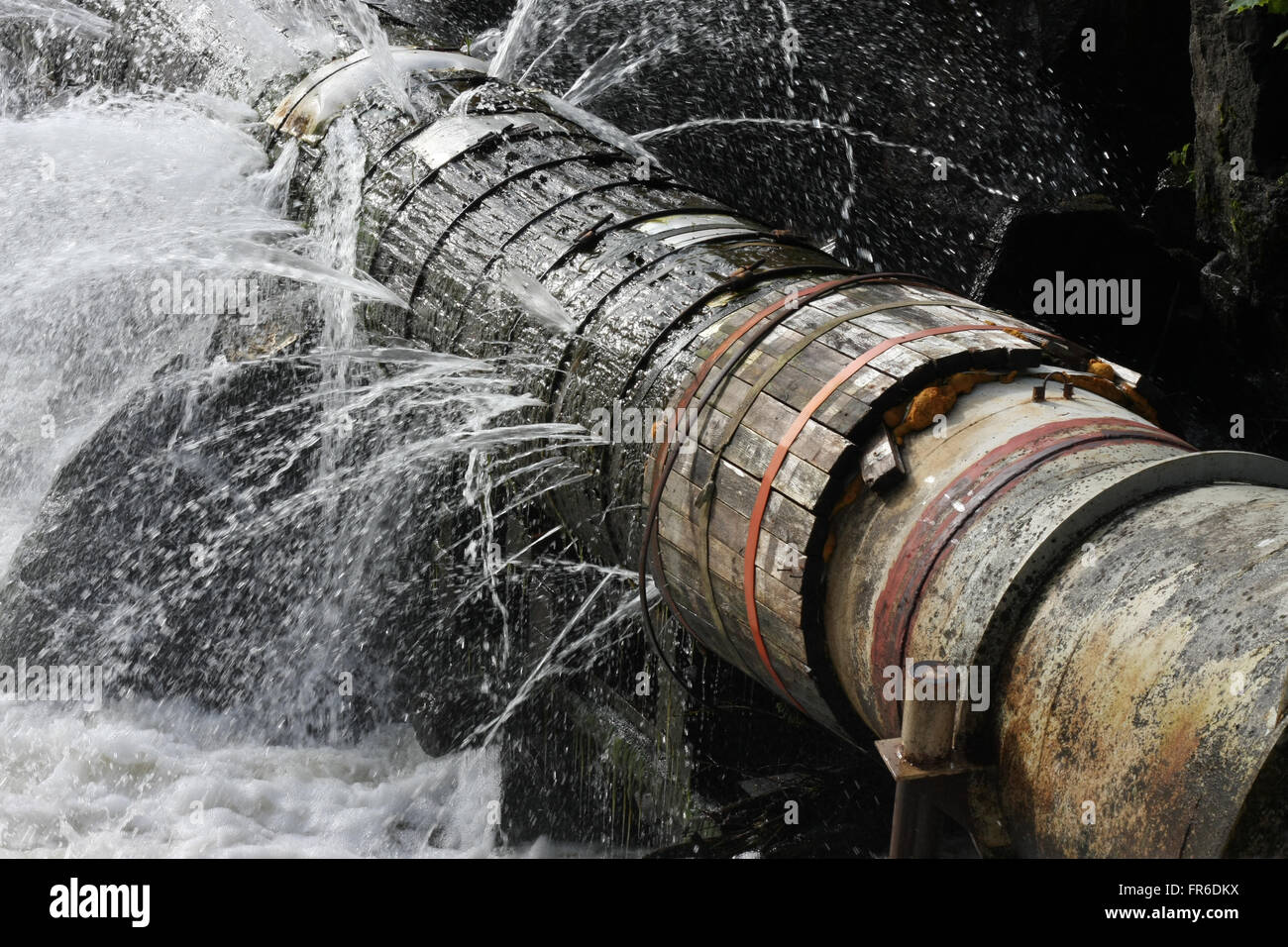 A broken pipe that leaks water in all directions. Symbol for plumbing or disastrous technical level or status. - Stock Image