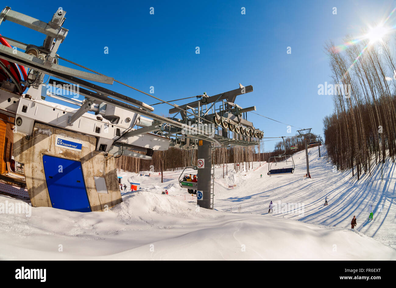 Chairlift in 'Krasnaya Glinka' mountain ski resort in winter sunny day in Samara, Russia - Stock Image