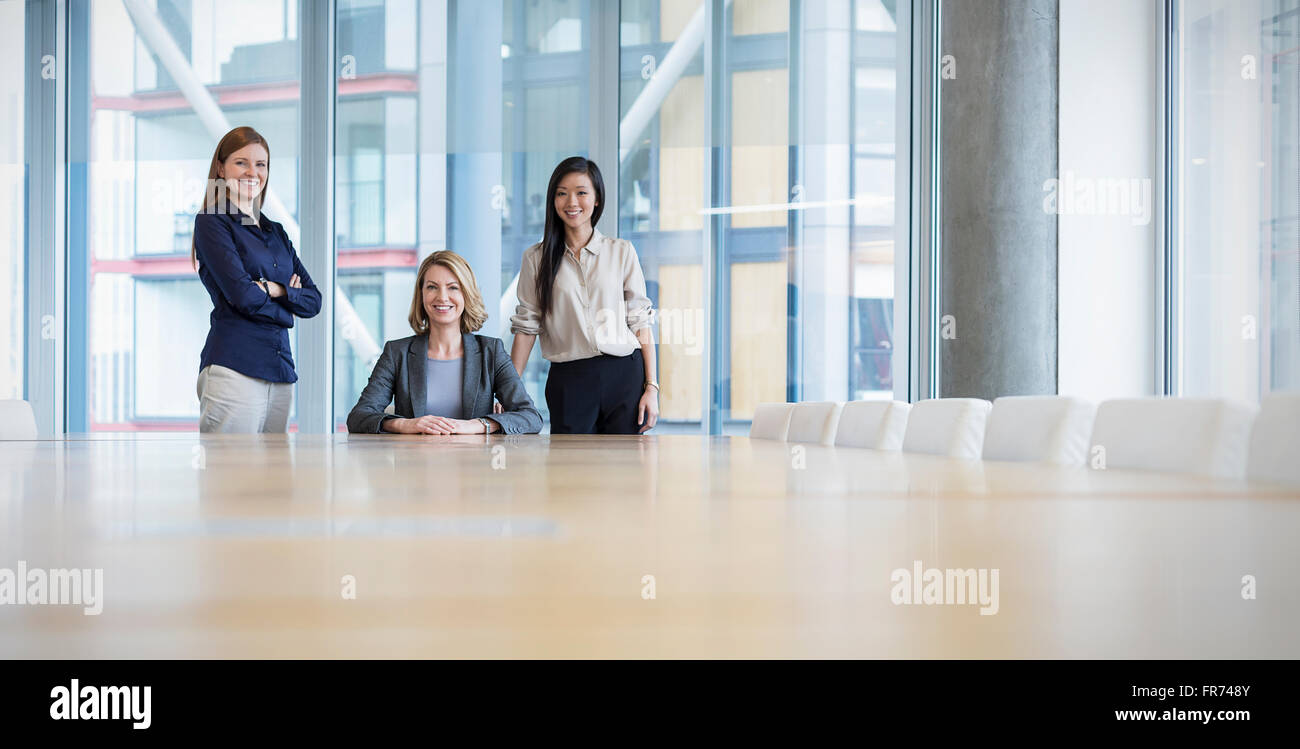 Surface level portrait confident businesswomen in conference room - Stock Image