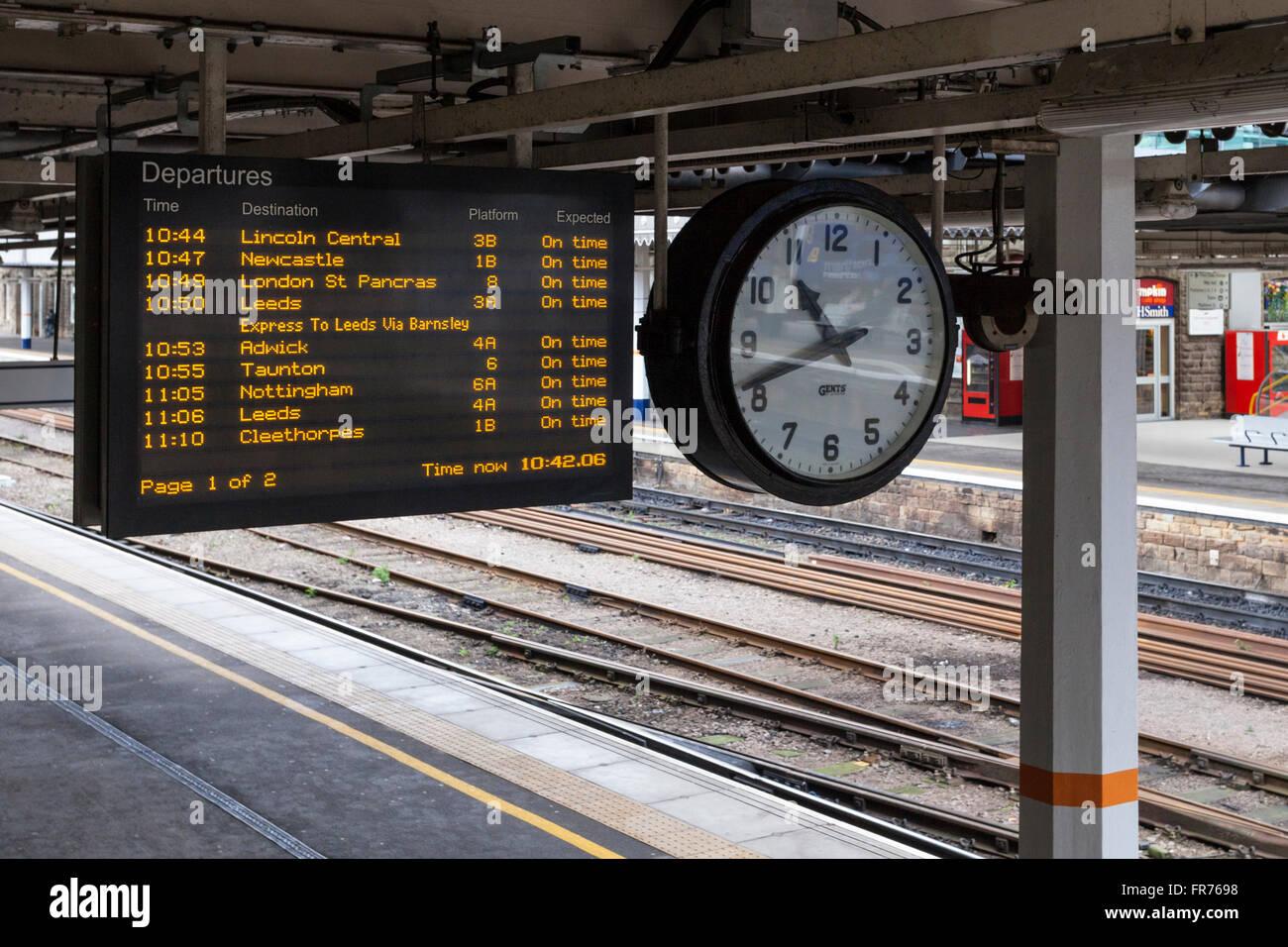 departure board station clock and platform at sheffield railway stock photo 100347556 alamy. Black Bedroom Furniture Sets. Home Design Ideas