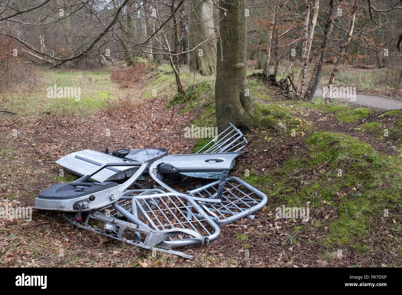 Fly Tipping Rubbish dumped in Ashridge Forest, Hertfordshire - Stock Image