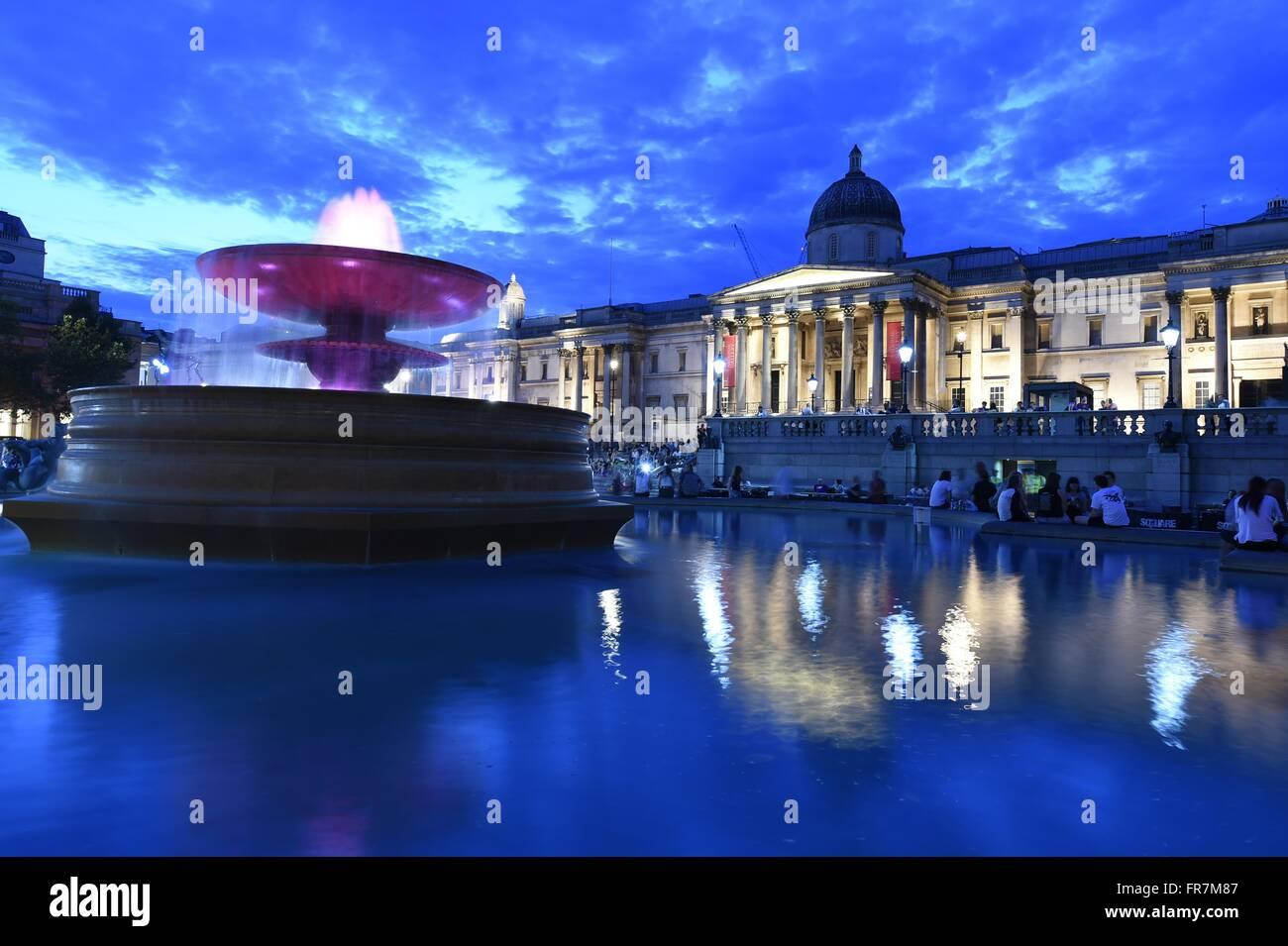 Trafalgar square, National Gallery, night, water, fountains, Tourist, London, UK, - Stock Image