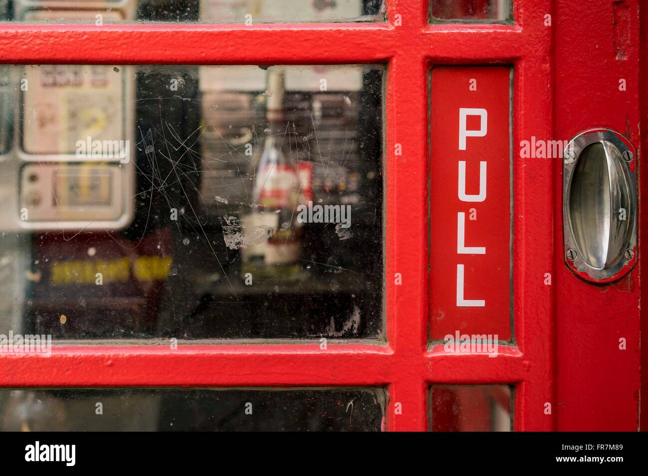 View in through the door of a red public telephone box,London, UK - Stock Image