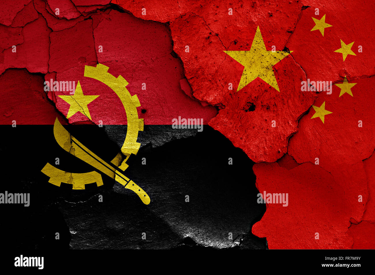 flags of Angola and China painted on cracked wall - Stock Image