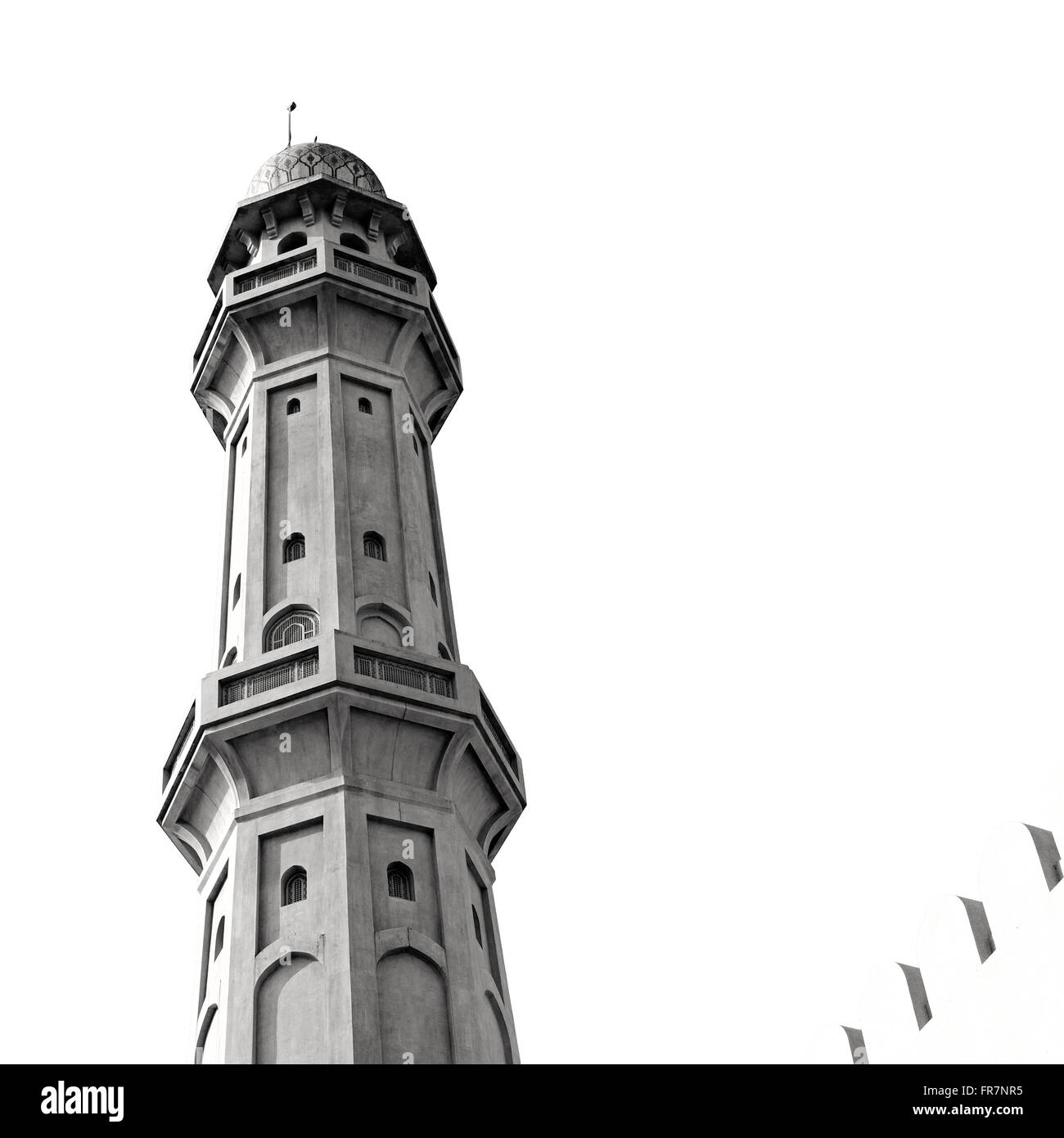 minaret and religion in clear sky in oman muscat the old mosque - Stock Image