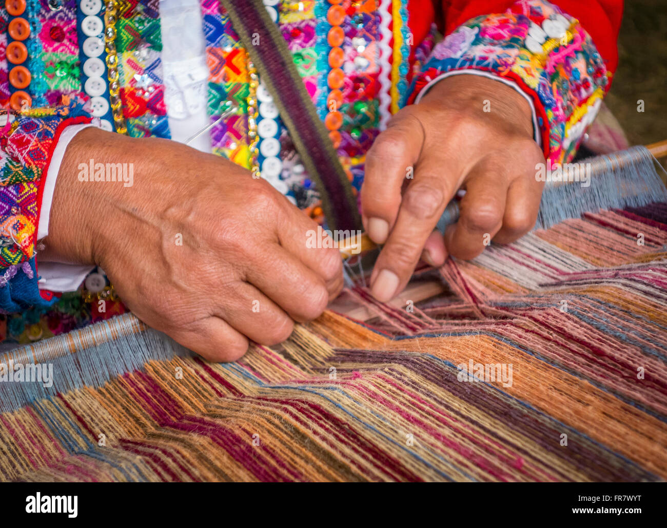 WASHINGTON, DC, USA - Woman fdemonstrates weaving with backstrap loom (awana), during 2015 Smithsonian Folk Life - Stock Image