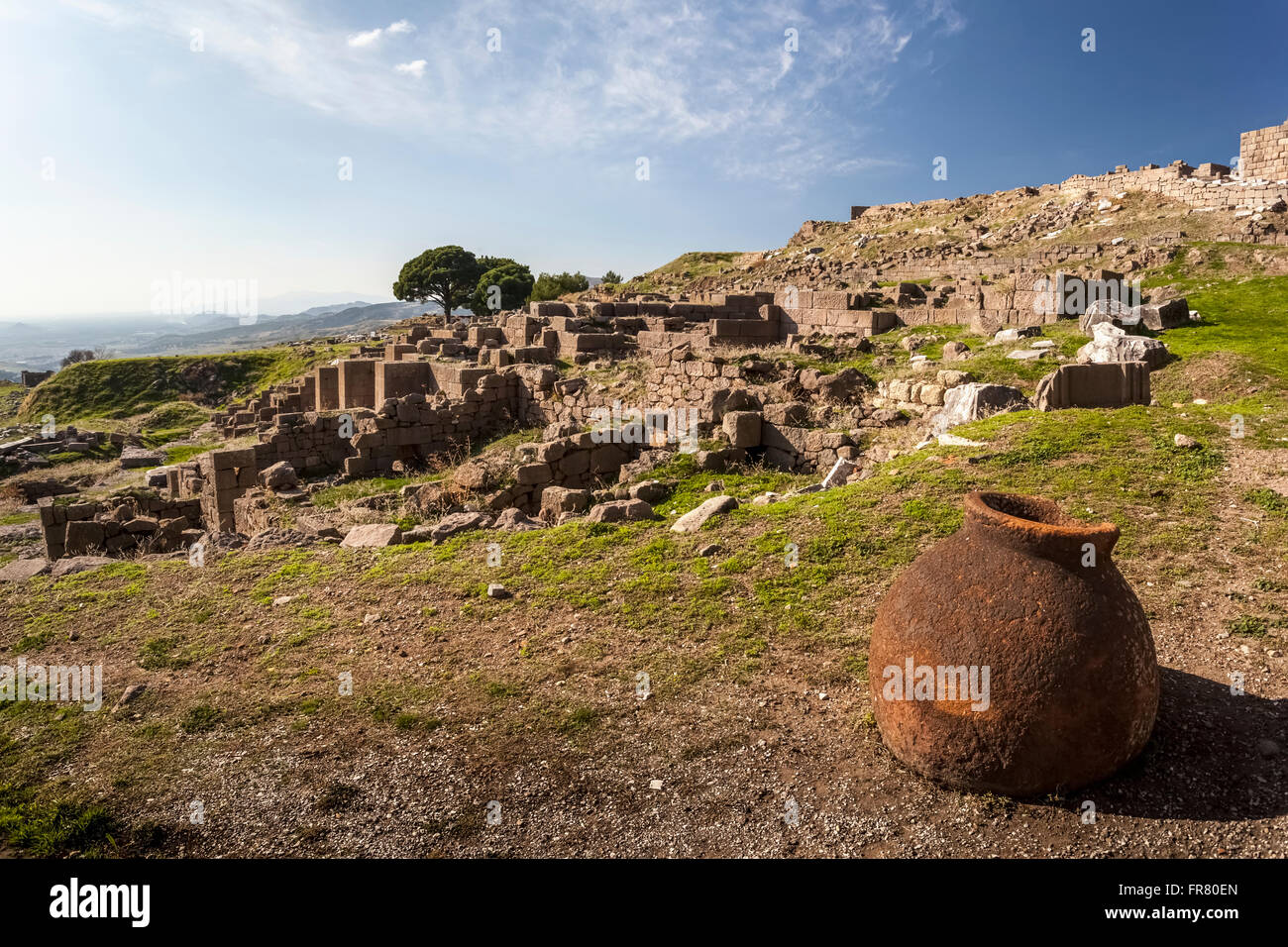 A clay water pot sits at the site of ancient ruins; Pergamum, Turkey - Stock Image