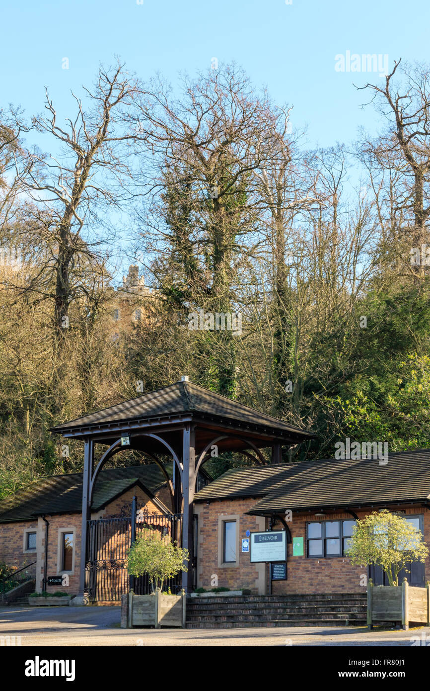 Belvoir Castle visitors entrance with the castle in the background car park , tea room and cafe - Stock Image