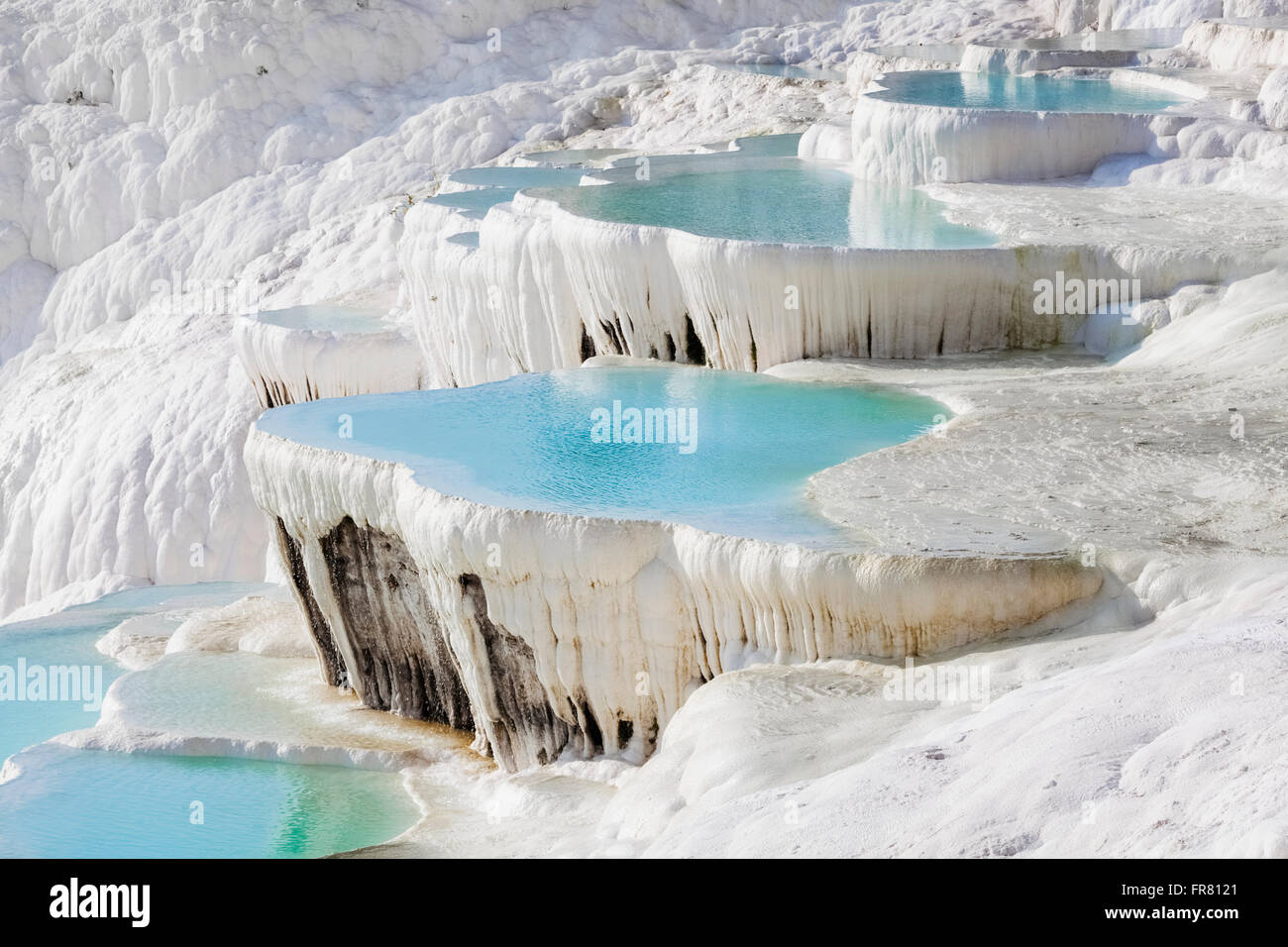 Hot springs and travertines, terraces of carbonate minerals left by the flowing water; Pamukkale, Turkey - Stock Image