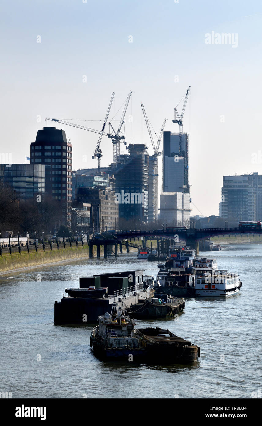 London, England, UK. Construction work, flats and cranes in Vauxhall, boats on the River Thames seen from Westminster - Stock Image