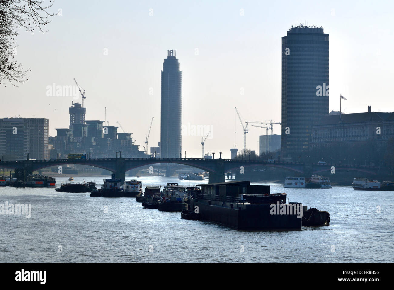 London, England, UK. Construction work, flats and cranes in Vauxhall, boats on the River Thames seen from Westminster Stock Photo