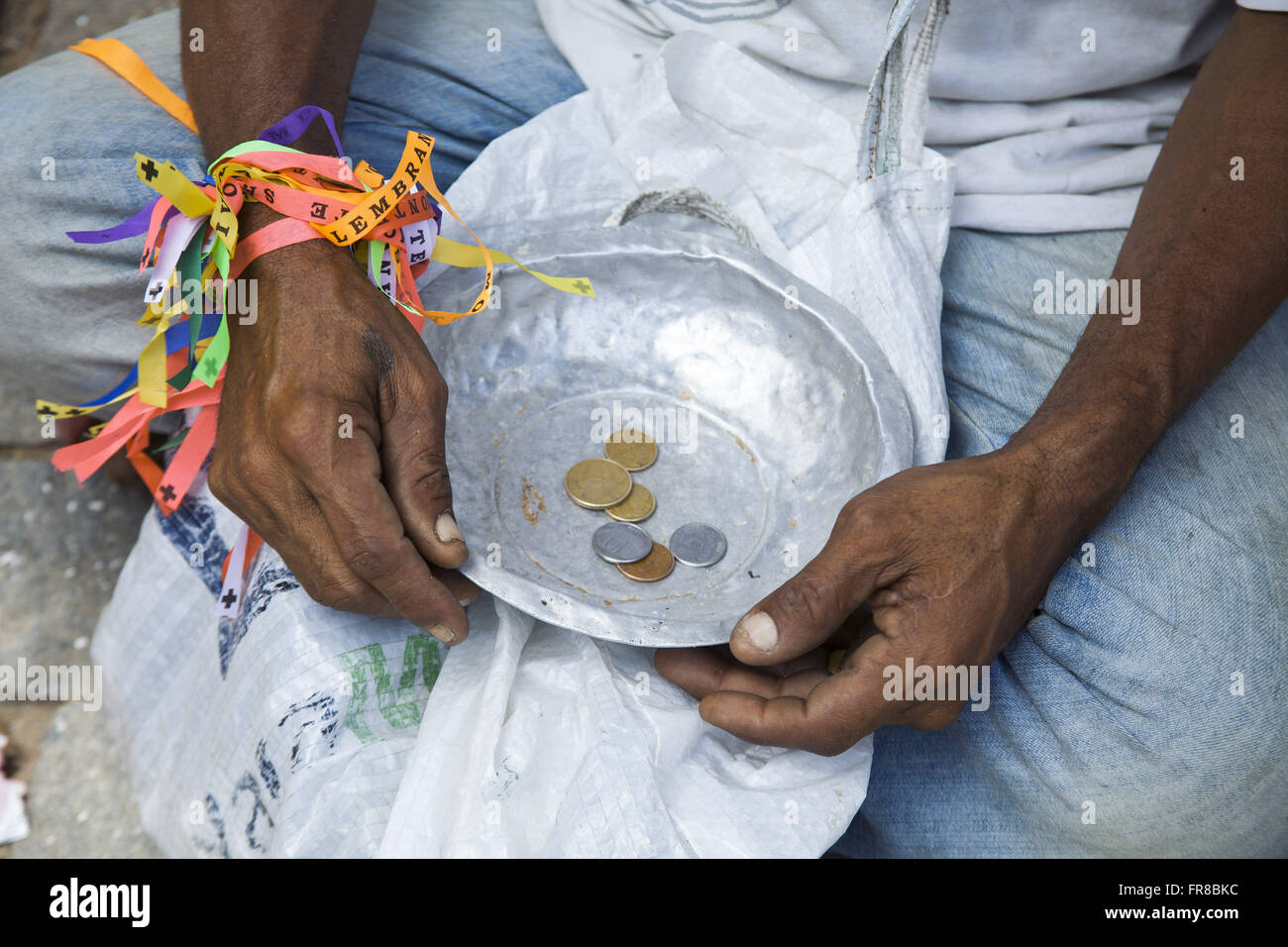 Man begging on the Feast of All Saints - Stock Image