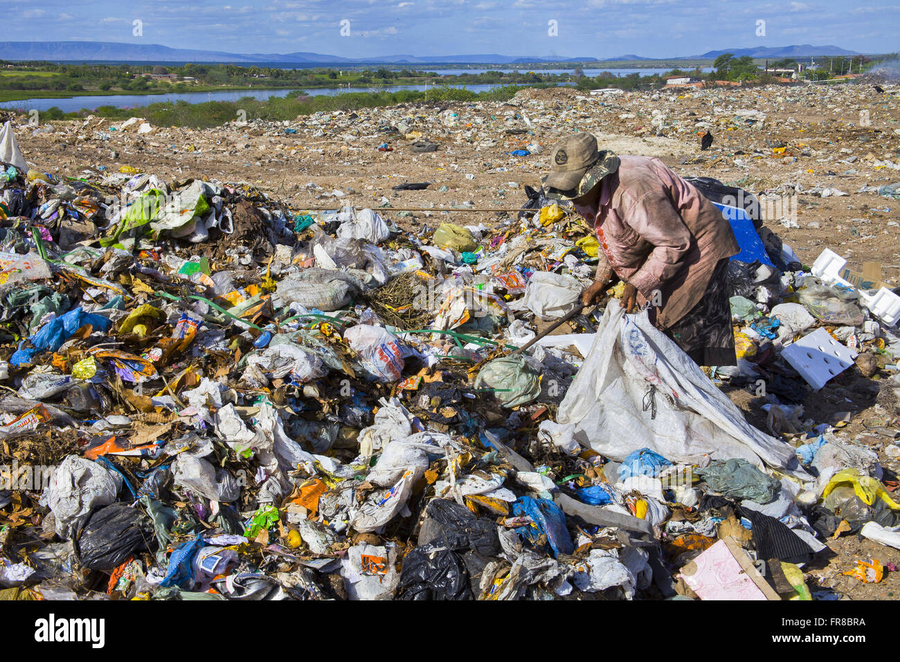 Garbage collector in sanitary landfill ARPA - Alternative Recycling Paulo Afonso - Stock Image