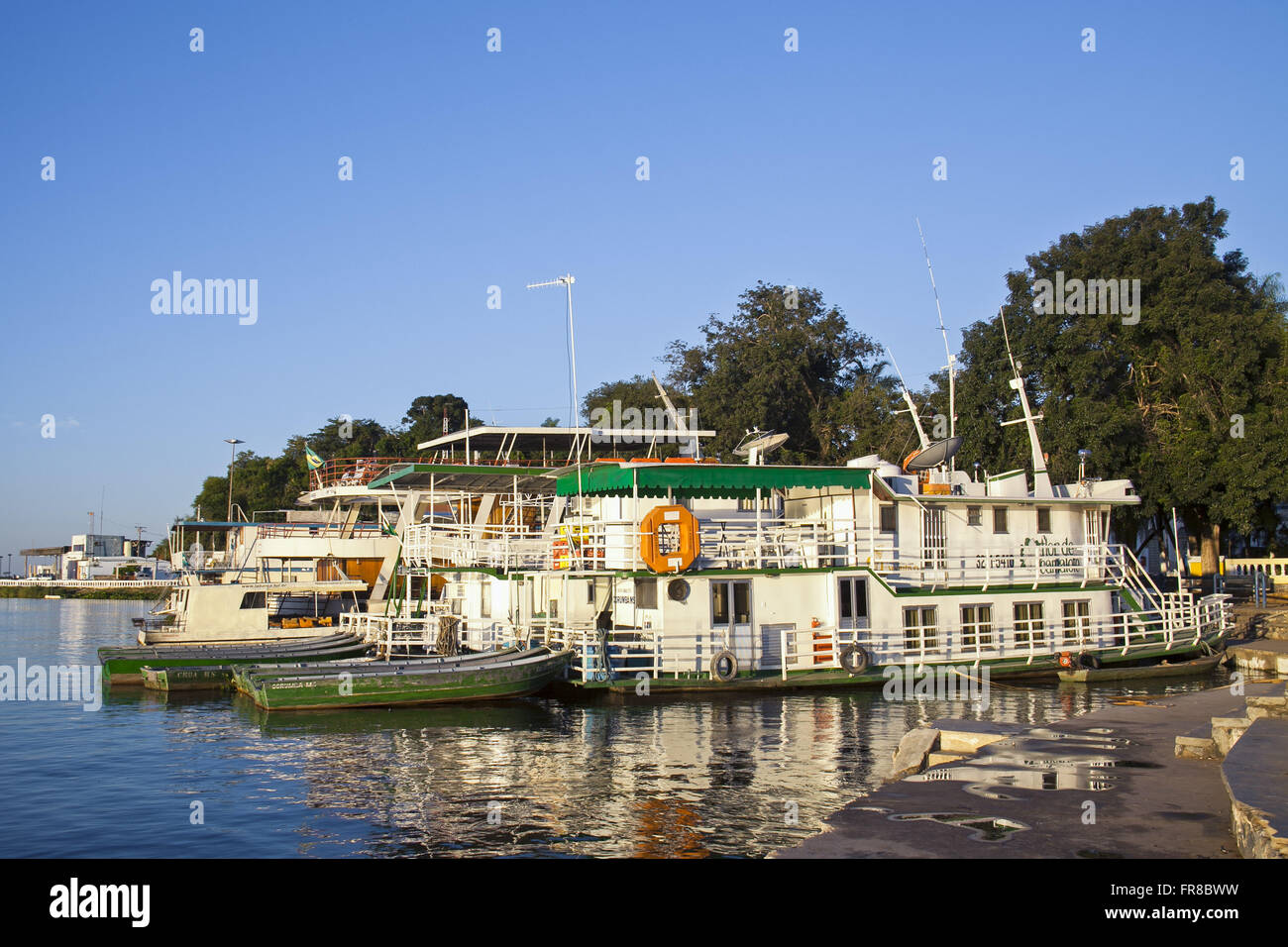 Lighters moored on the River Paraguay - Port General - Stock Image