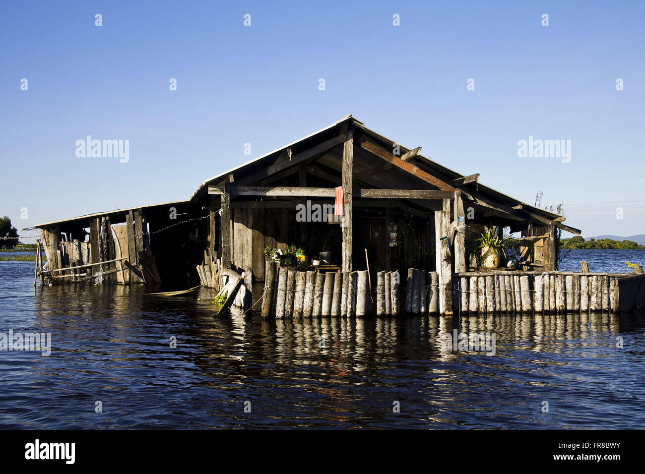 Riverside house on the edge of the Paraguay River flooded by mare-high - Sharpening the Saw Stock Photo