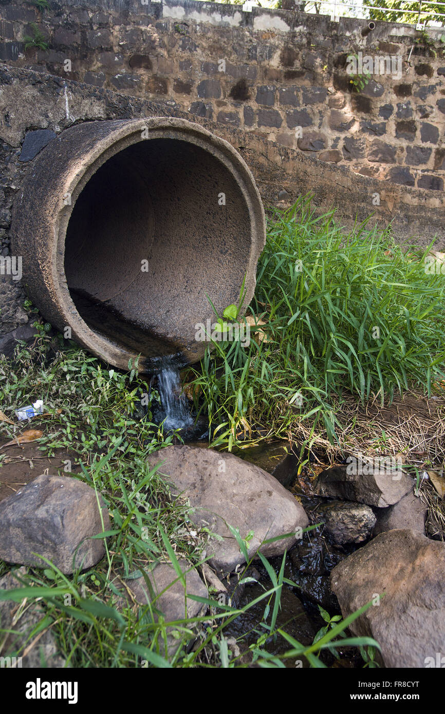 Sewage pipeline on the banks of the river Piracicaba - Stock Image