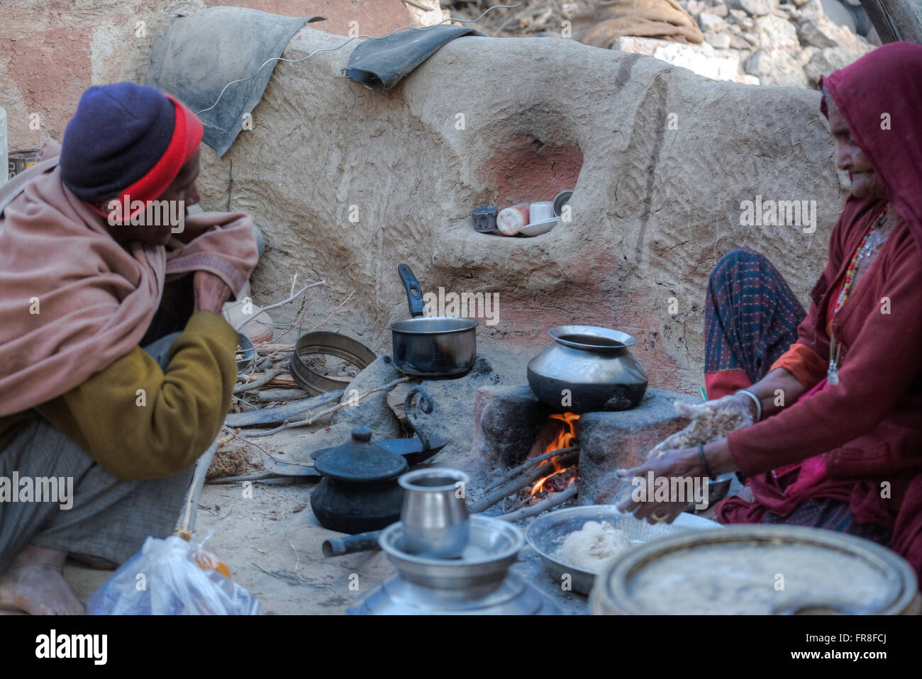 woman in a tribal village near Jodhpur is baking ciabatti in her outdoor kitchen Stock Photo