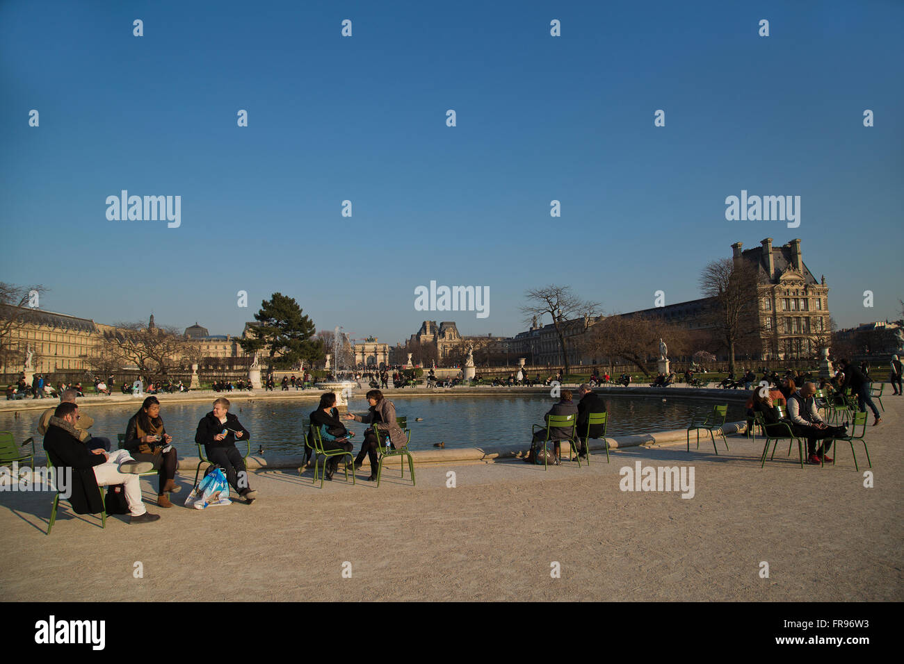 Parisians relaxing in the Jardin des Tuileries in Paris, France in winter - Stock Image